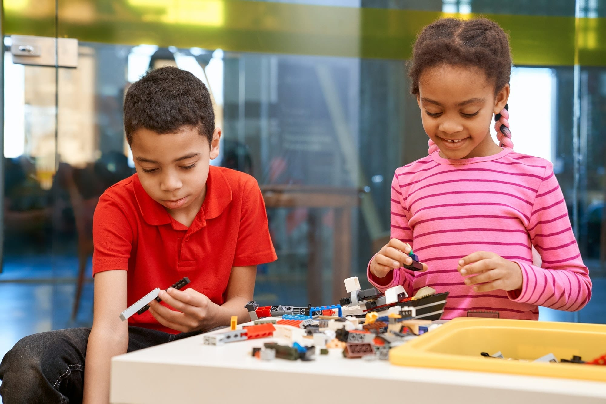 African girl and boy creating toys